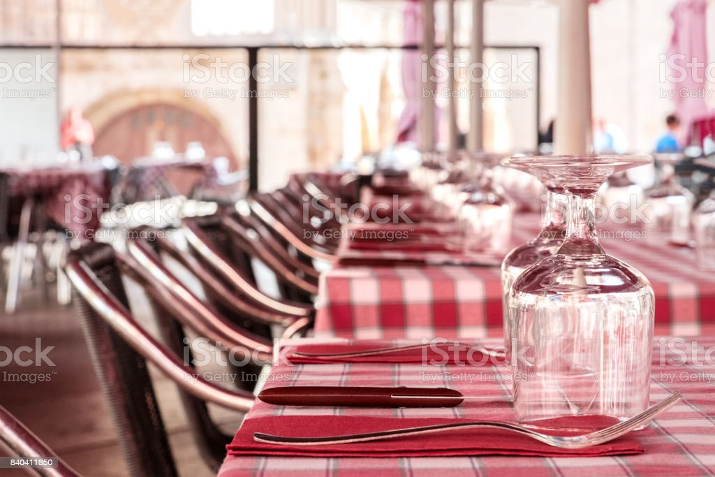 Street cafe with tables set, blurred background for copyspace stock photo