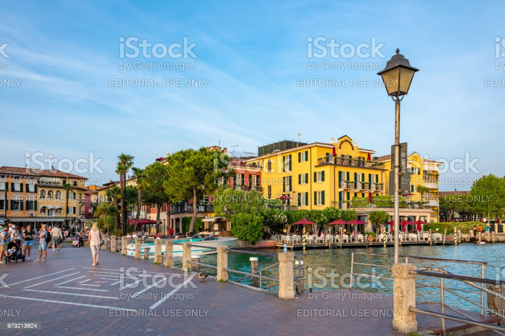 Street cafes and the quayside in Sirmione on Lake Garda, Italy stock photo