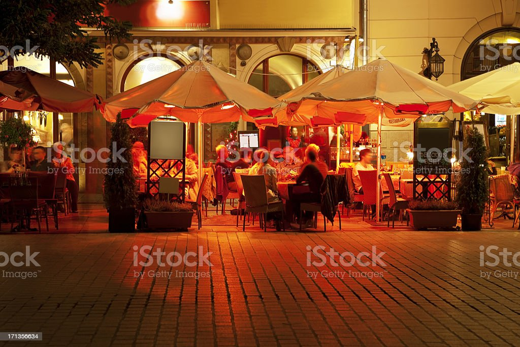 Street Cafes in Market Square at Night, Cracow, Poland stock photo