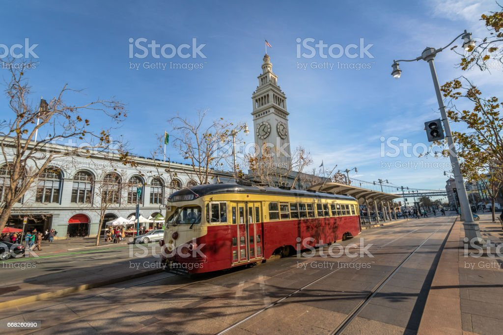 Street car or trollley or muni tram in front of San Francisco Ferry Building in Embarcadero - San Francisco, California, USA stock photo