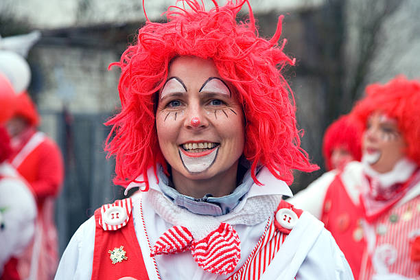 Street carnival in Cologne with female clown stock photo