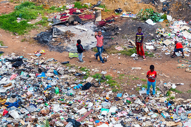 street children playing at a dumpsite - disinherit stock pictures, royalty-free photos & images
