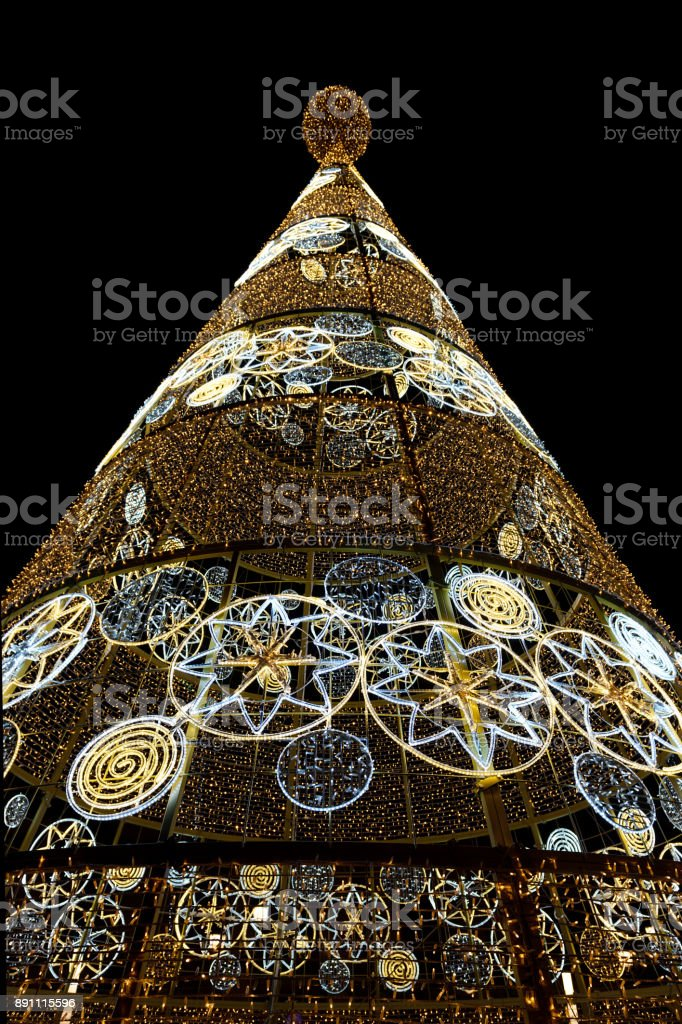 street Christmas tree from the lights of garlands stock photo
