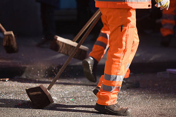 Street cleaner Street cleaners sweeping am confetti in street street sweeper stock pictures, royalty-free photos & images