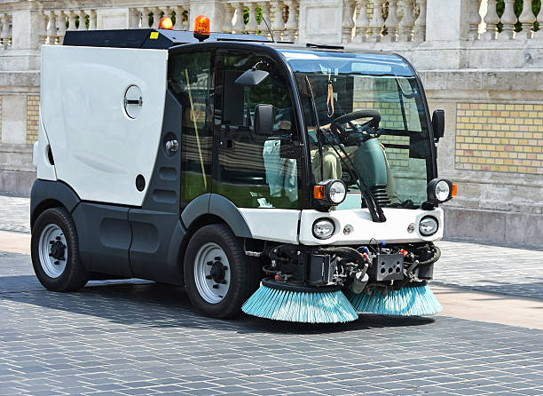 Street cleaner vehicle at work Street cleaner vehicle at work in the city street sweeper stock pictures, royalty-free photos & images