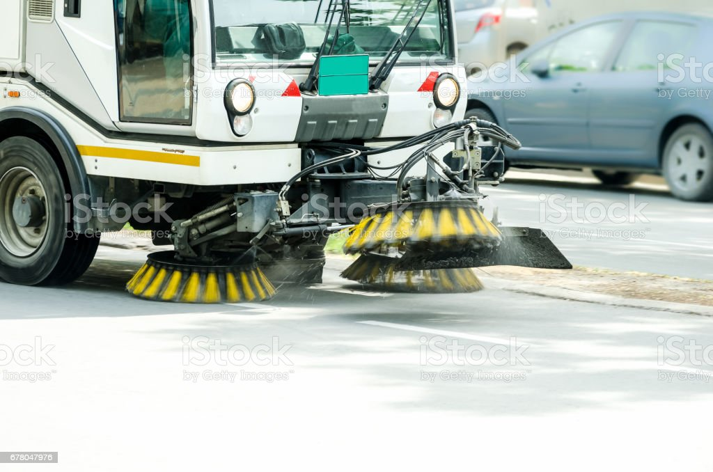Street cleaner vehicle on the road. Vehicle sweeper with motion blur. stock photo