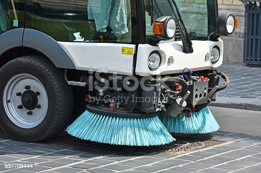 Street cleaner vehicle in the city
