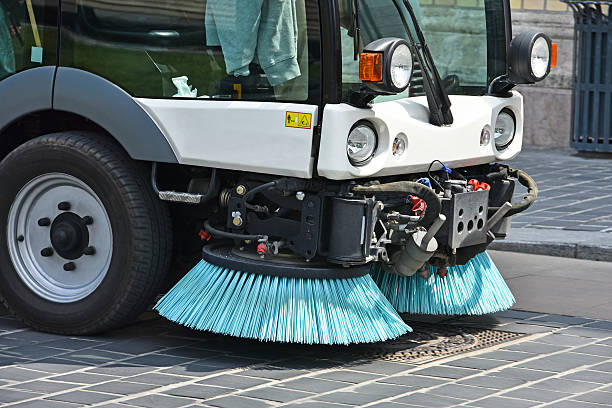 Street cleaner vehicle Street cleaner vehicle in the city street sweeper stock pictures, royalty-free photos & images