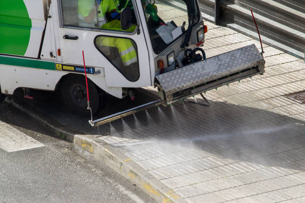 Street cleaning machine working in city stock photo
