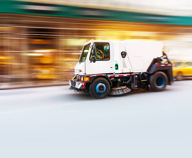 Street cleaning truck Street sweeper truck speeding in New York - motion blur street sweeper stock pictures, royalty-free photos & images