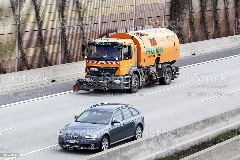 Street cleaning vehicle on motorway royalty-free stock photo