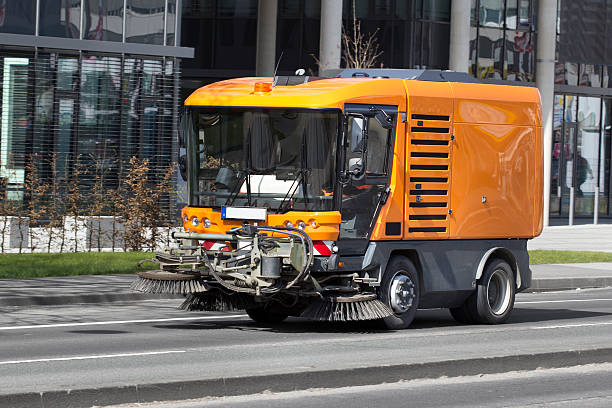 Street cleaning vehicle Street cleaning vehicle street sweeper stock pictures, royalty-free photos & images