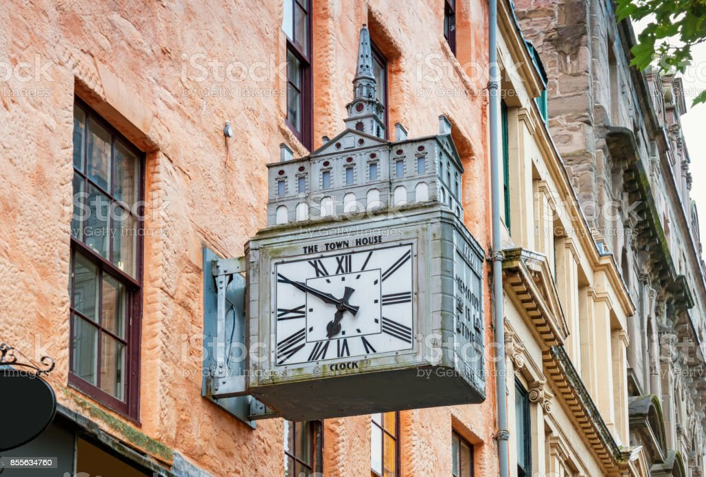 Street clock featuring old town hall in Dundee Scotland UK stock photo