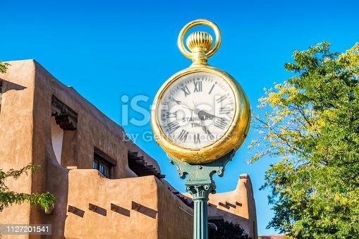 Stock photograph of a street clock on Santa Fe Plaza in downtown Santa Fe New Mexico on a sunny day.