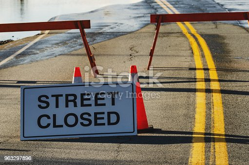 Street closed due to flooding.