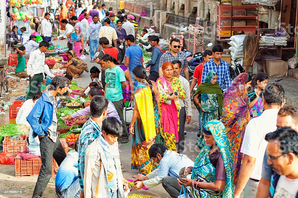 Street Crowded with People in Jaipur, India Crowded street market full of people in Jaipur, Rajasthan, India.  2015 Stock Photo