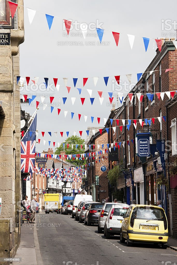 Street decorated with bunting for the Queens Diamond Jubilee stock photo