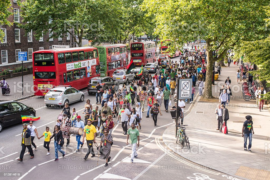 Street demonstration with people marching in a busy road stock photo