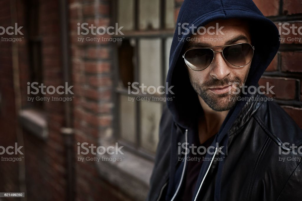 Street fashion fellow in shades and hood, looking away foto stock royalty-free