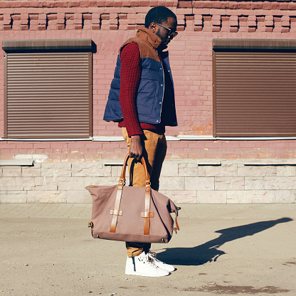 627398448 istock photo Street fashion look concept stylish african young man 636345302