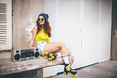 Hip hop style female with boom box radio and roller skates