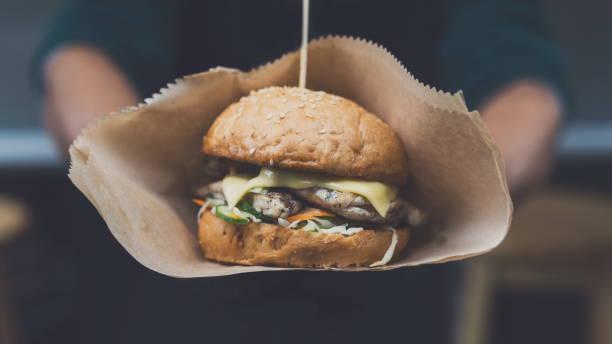 Street fast food festival, hamburger with bbq grilled steak stock photo