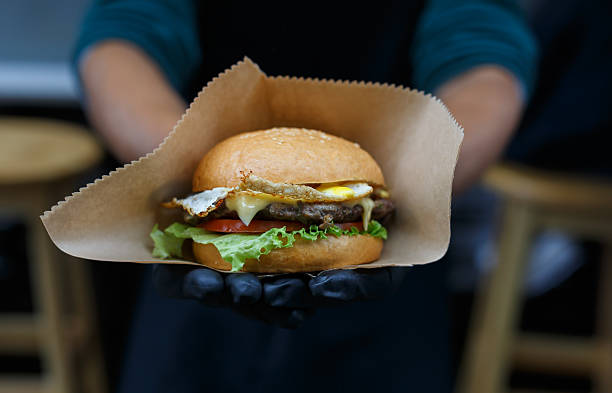 Street fast food, hamburger with bbq grilled steak stock photo