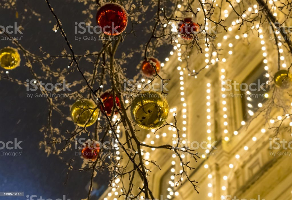 street festive decoration of the city for Christmas and new year bright shiny balls of golden red on trees stock photo
