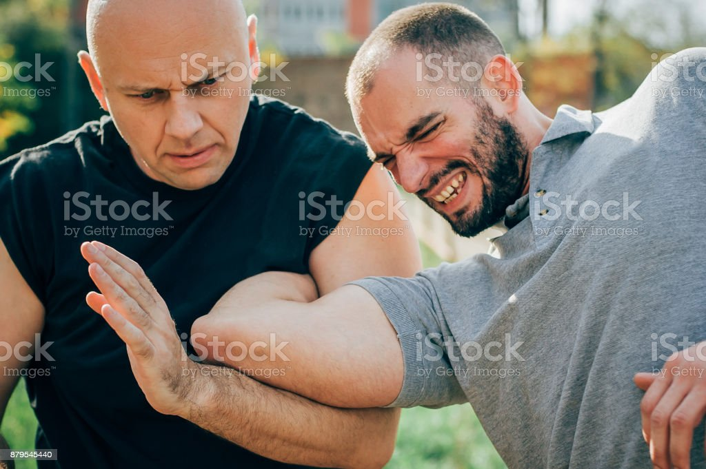 Street fight. One man fight with other. Street fighting stock photo