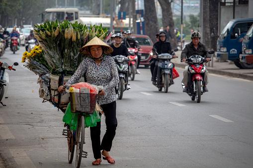 Street flower seller Hanoi