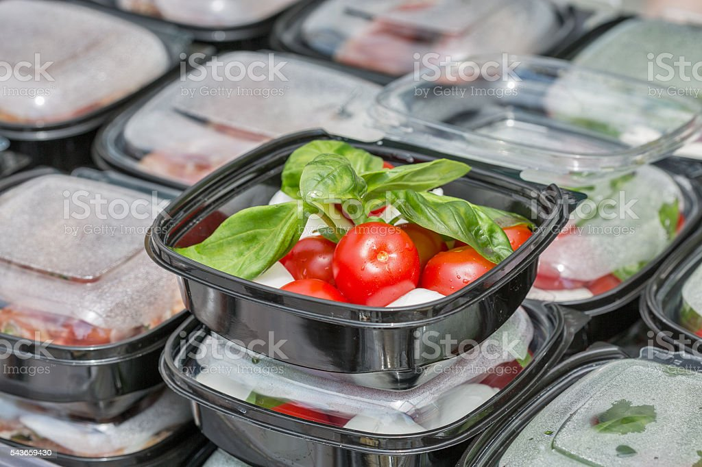 Street food box with mozzarella cheese, cherry tomatoes and basil. stock photo