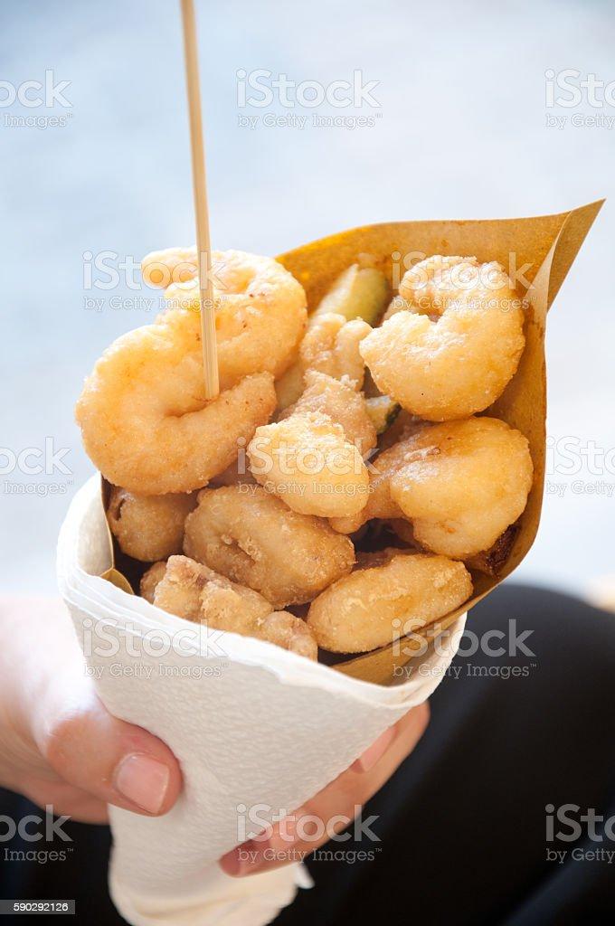 street food calamari and fried vegetables in a paper cone royaltyfri bildbanksbilder