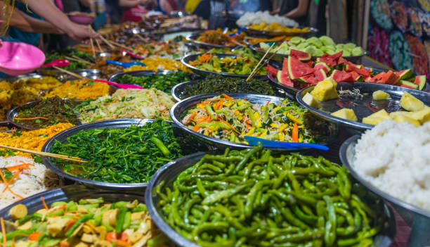 Street food in Luang Prabang, Laos. Delicious food stall selling colorful vegetable dishes to tourist. Asian cuisine, tasty food, healthy lifestyle. stock photo