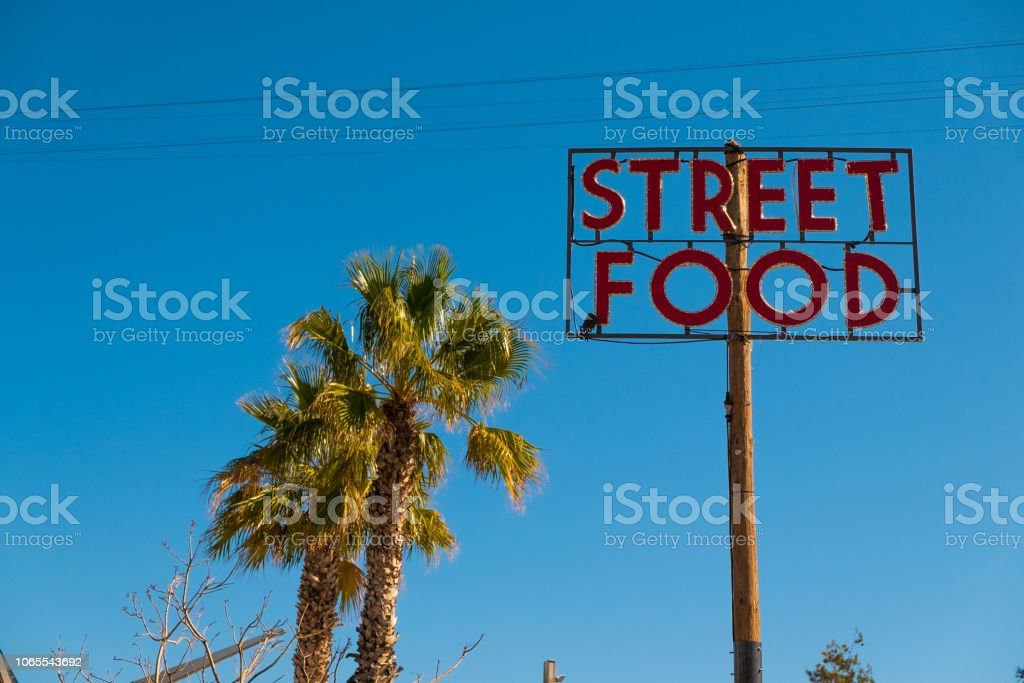 street food sign with palm trees in sunny blue summer day stock photo