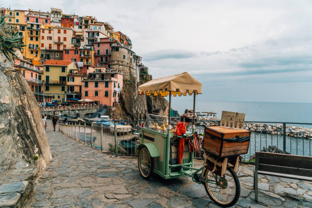 Street food stall in street of Manarola, Cinque Terre, Liguria, Italy stock photo