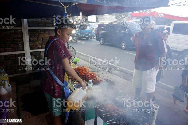Street food vendor at her food stall sells grilled pork and chicken picture id1211359366?b=1&k=6&m=1211359366&s=612x612&h=ww4b9thzi 2bqjz9l6dncqb ananrolthohopbf9qpo=