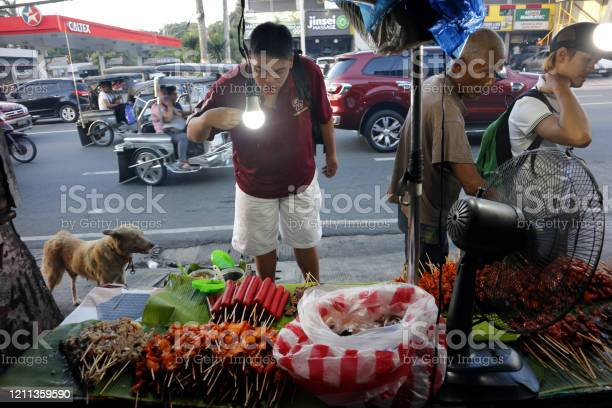 Street food vendor at her food stall sells grilled pork and chicken picture id1211359590?b=1&k=6&m=1211359590&s=612x612&h=fmcbolde jn2vzd64witvqzllssonwrw4f1h5e8l9gg=