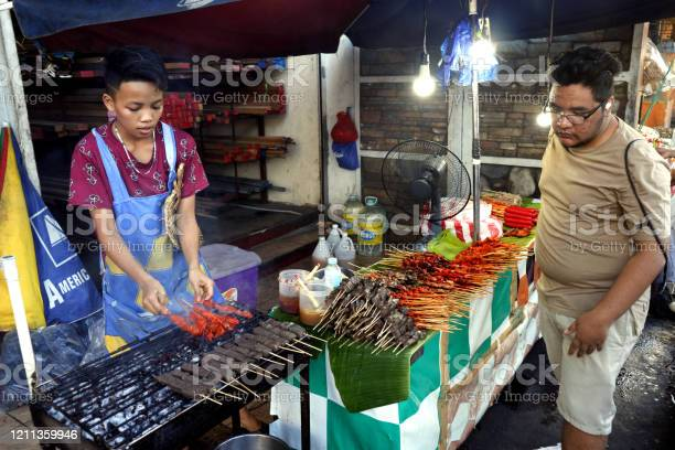Street food vendor at her food stall sells grilled pork and chicken picture id1211359946?b=1&k=6&m=1211359946&s=612x612&h=mb45x5cn22mshpzxl016wjpi331bahbv3vdr 196j9m=