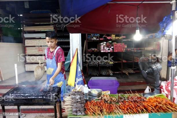Street food vendor at her food stall sells grilled pork and chicken picture id1211451361?b=1&k=6&m=1211451361&s=612x612&h=1qbwuvuurml3vowyhurljitin9zaotnz7k5c7vy ggw=