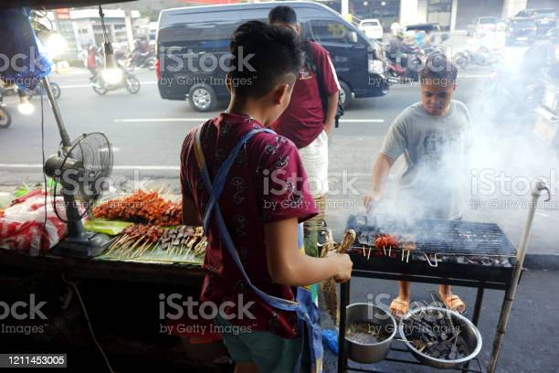 Street food vendor at her food stall sells grilled pork and chicken picture id1211453005?b=1&k=6&m=1211453005&s=612x612&h=smgb nwum8vnbkef 4cbjpwu1lyg6fgsx6c2d8u2xmi=