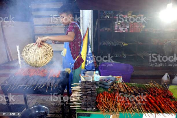 Street food vendor at her food stall sells grilled pork and chicken picture id1211453103?b=1&k=6&m=1211453103&s=612x612&h=ukfihmq1metngmnlurfwza21bxxyeqz3aiocdjlb 64=