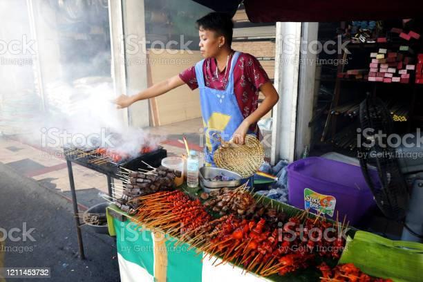 Street food vendor at her food stall sells grilled pork and chicken picture id1211453732?b=1&k=6&m=1211453732&s=612x612&h=vhbgu3jnd5die0ynr2zp9cmjjwtboj7ygbt2ivbzovw=