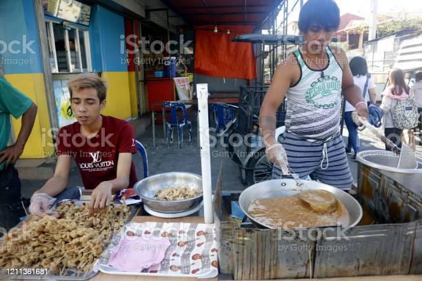 Street food vendor at their food stall sells deep fried chicken picture id1211361681?b=1&k=6&m=1211361681&s=612x612&h=njd8x2wsh6coqh7xqucb v2ggayw32lo7 l3wcmfzxu=