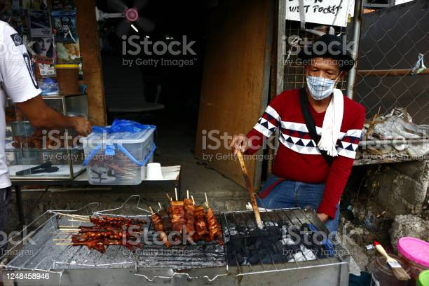 Street food vendor grills and sell assorted chicken and pork meat and picture id1248458946?b=1&k=6&m=1248458946&s=612x612&h=kig9 f7khgdtnuquujgymvgnqcotiqy3a4vy6jbyjqq=