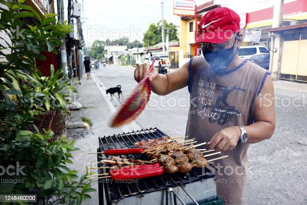 Street food vendor grills and sell assorted chicken and pork meat and picture id1248460200?b=1&k=6&m=1248460200&s=612x612&h=tvsnmclwftxn9 zrvkhygd esemwonsataexfolpqcy=