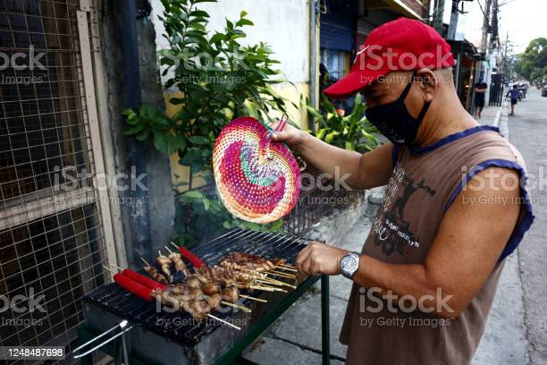 Street food vendor grills and sell assorted chicken and pork meat and picture id1248487698?b=1&k=6&m=1248487698&s=612x612&h=wzvd3mkgwou mtsgq6ww6uhffmfanfujwhfrybjppe0=
