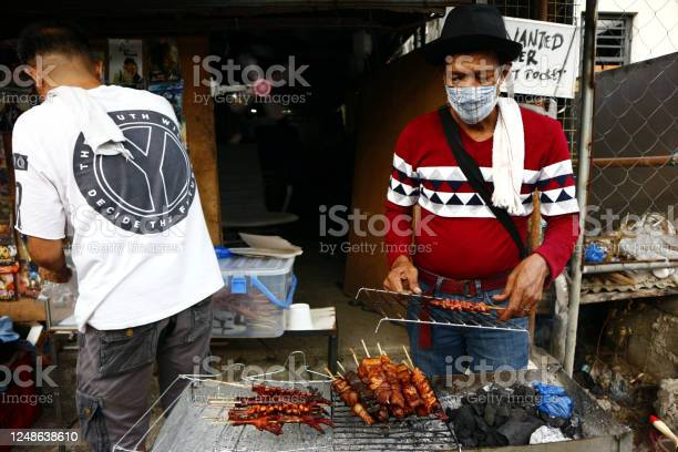 Street food vendor grills and sell assorted chicken and pork meat and picture id1248638610?b=1&k=6&m=1248638610&s=612x612&h=6hpocko5he3qsl9ytp wua1wfbap4vpkcpscg5yac7y=
