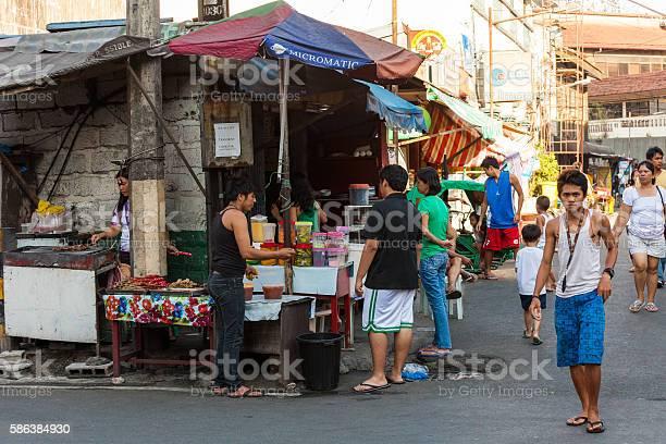Street food vendor in manila philippines picture id586384930?b=1&k=6&m=586384930&s=612x612&h=n2784djvesrqsmx8xkjugonji 4futaiwhwfy1c krc=