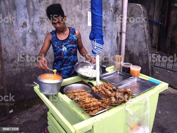 Street food vendor sells a variety of street food picture id999673308?b=1&k=6&m=999673308&s=612x612&h=iewpqpuxukq7zgkeb cuzyabnhama5dvfu8dsogz5ci=