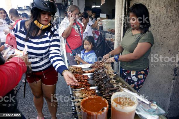 Street food vendor sells assorted grilled and fried pork innards in a picture id1205851055?b=1&k=6&m=1205851055&s=612x612&h=ocpkysjasdcxqr6 lek3oi8srs70 tacxftnzowvem0=